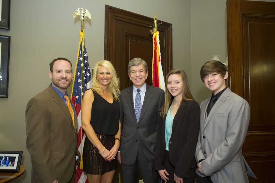 Ridgewood Middle School science teacher Ryan Widerman (left) and two of his students (right) pose with Missouri state representative Roy Blunt during the Solve for Tomorrow luncheon in Washington, D.C.