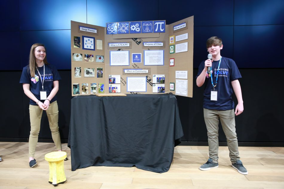 (Left to right) Madisyn Robinson and Dakota Stout from Ridgewood Middle School in Missouri present their project during the Solve for Tomorrow pitch event.