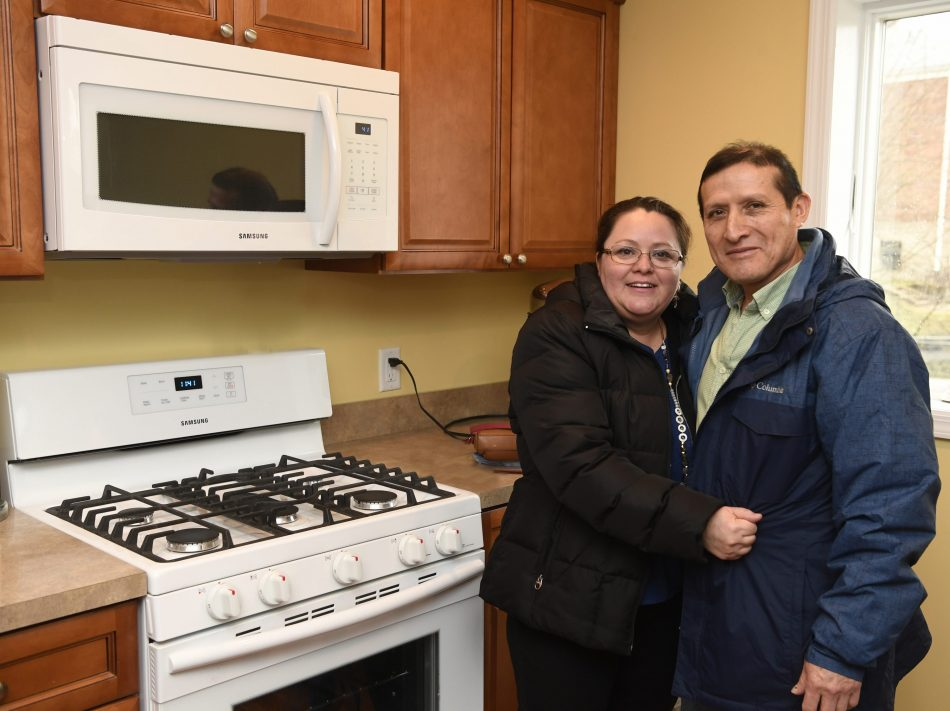 The Pimentel family in their new kitchen filled with Samsung home appliances