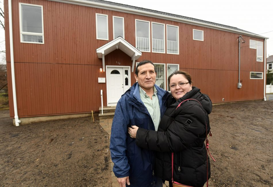 New homeowners Carlos and Geovana Pimentel outside their home HABITAT FOR HUMANITY SAMSUNG