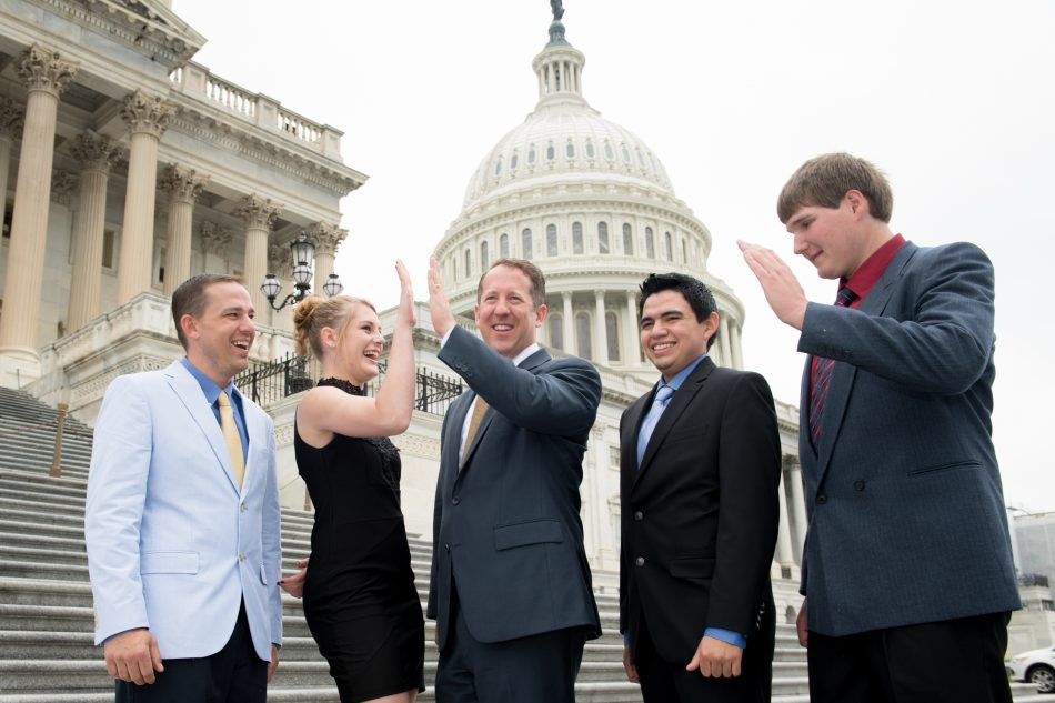 Gering High School students Elexus Johnson, Eric Crane and Payton Welfl celebrate being named a national winner in the Samsung Solve for Tomorrow contest with Congressman Adrian Smith (R-NE) on the steps of the U.S. Capitol on Wednesday, April 26, 2017.