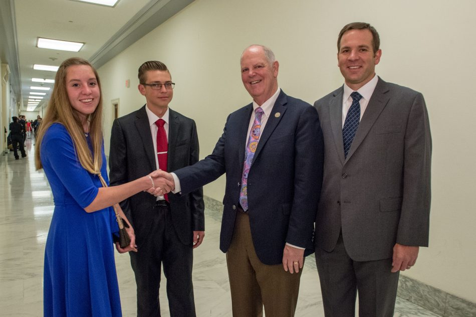 Snowflake Junior High School students Corynn Cottrell and Dylan Neff, and teacher Michael Eilertsen are congratulated by Congressman Tom O'Halleran for being named one of the three national winners in the Samsung Solve for Tomorrow Contest while in Washington, DC on Wednesday, April 26, 2017.