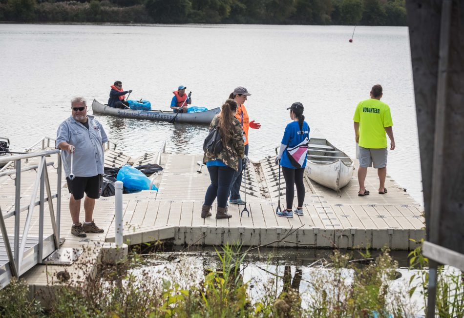 Samsung Electronics America employees work with Hackensack Riverkeeper to clean up the area around Samsung NAHQ and then board canoes to clean up Overpeck Creek.