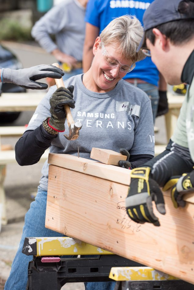 Samsung Electronics America employees assist Habitat for Humanity during Day of Service with their Township of Washington new affordable home construction work site of 4 homes for seniors and veterans.