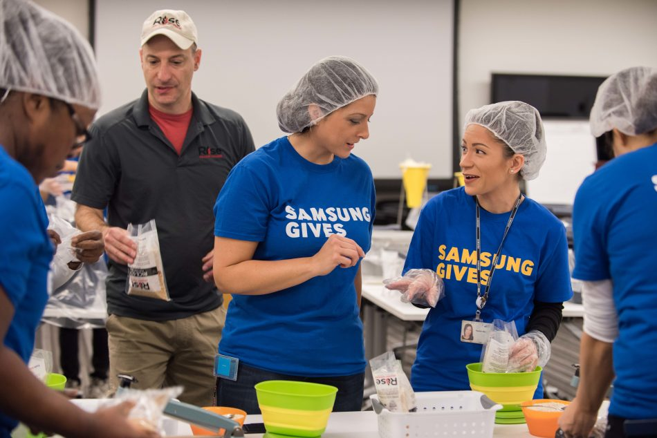 Samsung Electronics America employees work with Rise Against Hunger during Day of Service to pack 10,000 meal kits for children in need.