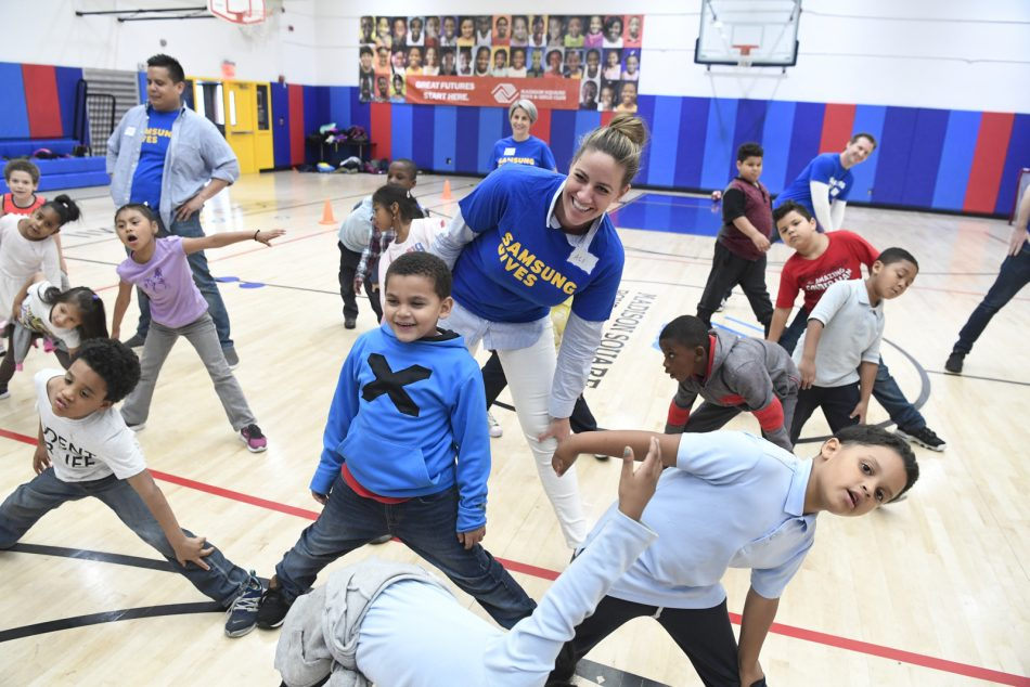 Samsung Electronics America employees assist Madison Square Boys & Girls Club members with homework and participate in club game activities during Day of Service.