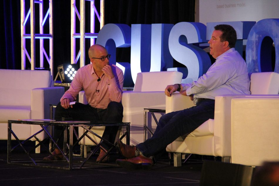 "Antony Brydon (left), Directly CEO, speaks with Michael Lawder (right), Sr. VP of Customer Care at Samsung Electronics America during the ""Execs In The Know"" panel at the Customer Response Summit in Chicago on September 20th."