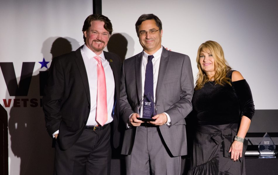 Christopher Peri (middle), a Samsung employee and a veteran, accepted the 2017 Vets in Tech Education Award on behalf of Samsung Electronics Ameria. Presenting the award were Chris Galy, a Vets in Tech Board Member (left) and Katherine Webster, Founder of Vets in Tech (right).