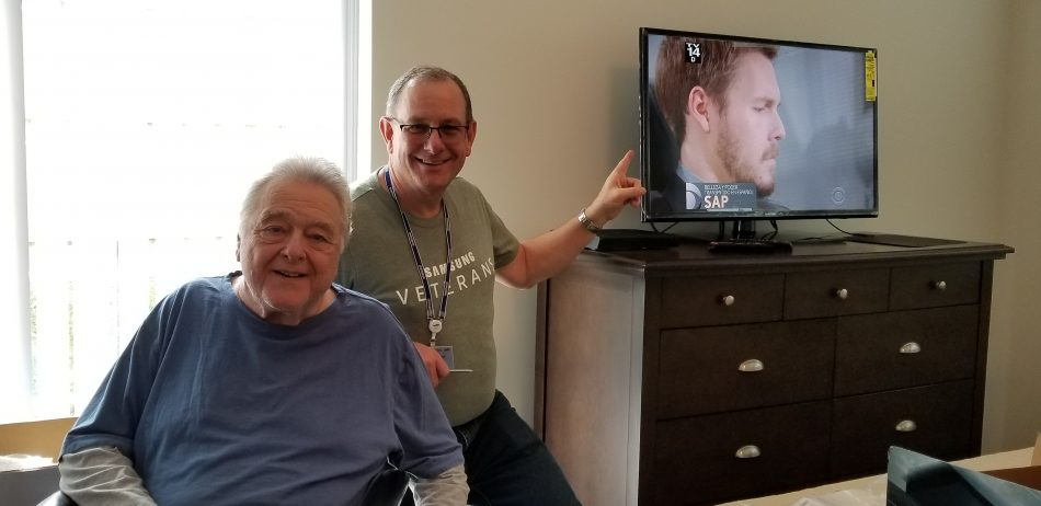 John Hendrick (right), Samsung Electronics America Veterans Community Chief Advocate, helped install TVs for local veterans moving into the Emerson Veterans Supportive Housing Complex.