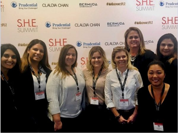 Reena Joseph (far left) joins her colleagues representing Women in Samsung Electronics (WISE) for a group photo while attending the S.H.E. Summit in New York City.
