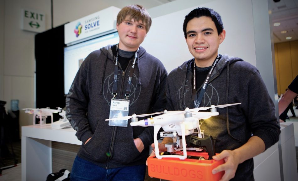 Student winners from Gering High School's 2016-17 Solve for Tomorrow competition team show off their winning idea using drone technology that helps farmers map crops to limit pesticide use.