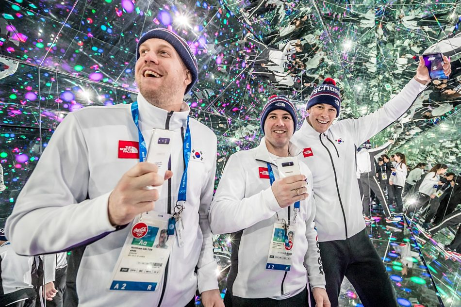 Inside the Infinity Room at Samsung Olympic Showcase in Gangneung Olympic Park, Matt Dalton, Michael Swift, and Mike Testwuide from the South Korea Men's National Ice Hockey team experience kaleidoscope like wondrous views controlled by PyeongChang 2018 Olympic Games Limited Edition.