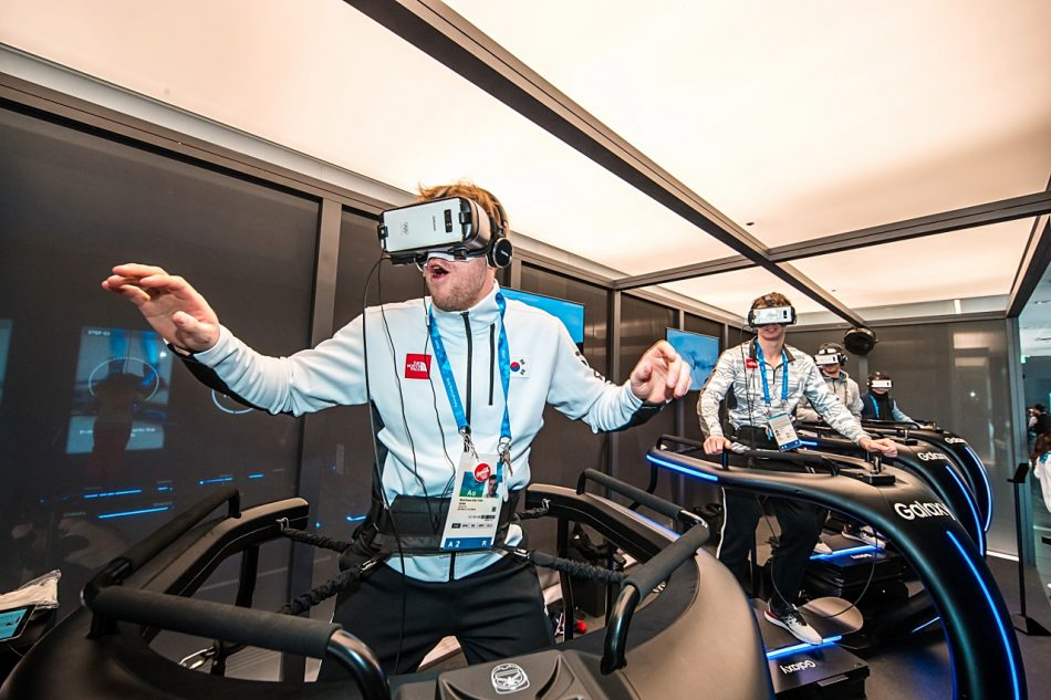 Matt Dalton from the South Korea Men's National Ice Hockey team feels the exhilaration of gliding down snowy mountains and precipitous cliffs through the Snowboarding VR experience at the Samsung Olympic Showcase in Gangneung Olympic Park in South Korea. The film is displayed through the Samsung Galaxy smartphone and compatible Gear VR.