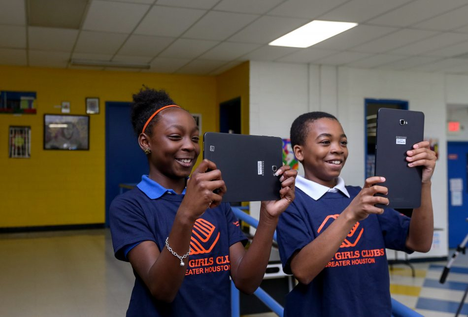 Students at the Johnny Mitchell Boys & Girls Club in Galveston, TX enjoy new Samsung tablets.
