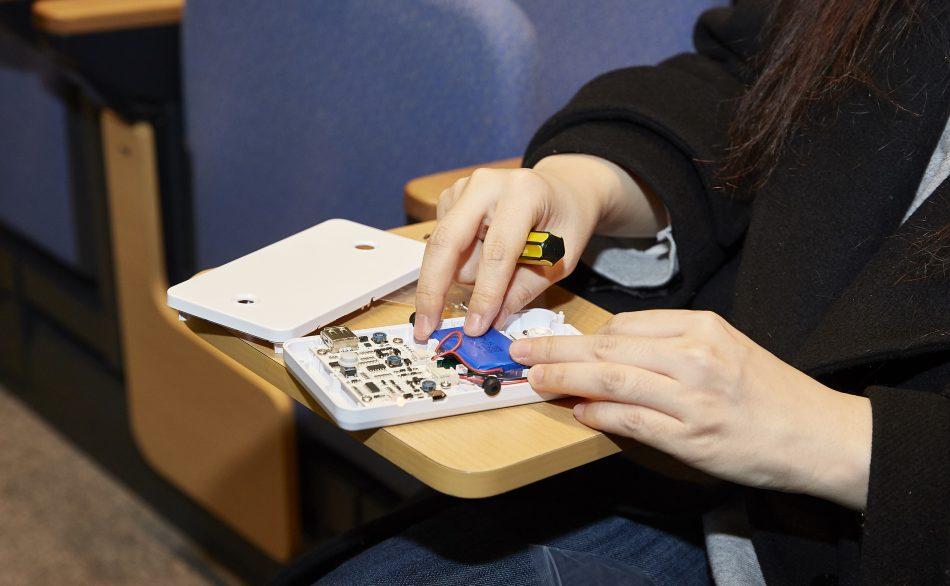 A Samsung Electronics employee assembles an LED lamp kit