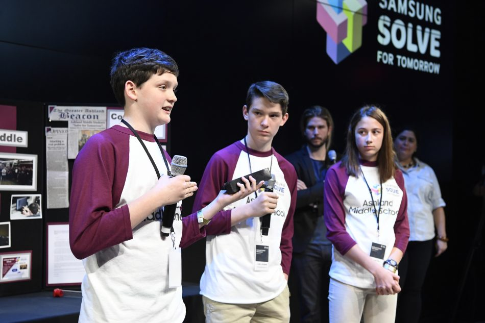 Students (left to right) Isaac Campbell, Caleb Campbell and Aubree Hay from Ashland Middle School in Ashland, KY present their STEAM project to a panel of judges at the Samsung Solve for Tomorrow national finalist pitch event on Monday, April 9, 2018 in New York City. The students created a device that allows first responders to safely collect hazardous needles left behind by opioid and other drug users.