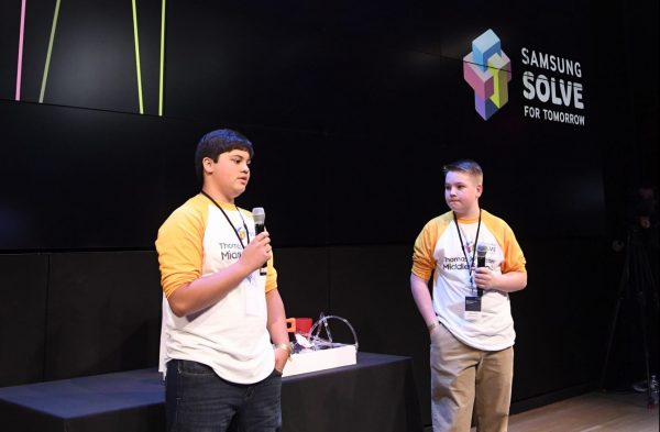 Students (left to right) Richard Little and Jake Gruver from Thomas Jefferson Middle School in Winston-Salem, NC, demonstrate their STEAM project – a water sensor and barrier system that deploys when water reaches unsafe levels to mitigate the effects of flooding – for the Samsung Solve for Tomorrow national finalist pitch event on Monday, April 9, 2018.