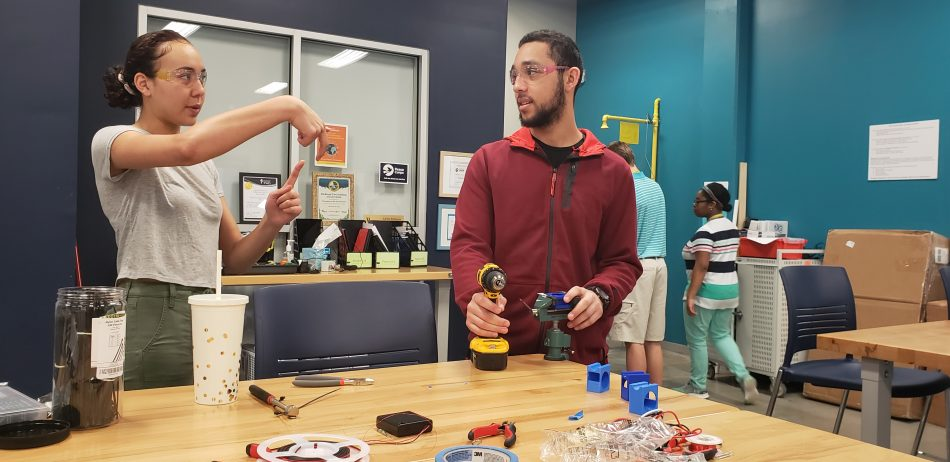 Emma T. (Left) and Fred T. (Right), student engineers on the national finalist team from Richland Two Institute of Innovation team, which built electromagnetic door locks and curtains that swiftly secure classrooms in the event of a school shooting. Photo credit: Kiana Wilcher, courtesy of Kirstin Bullington.