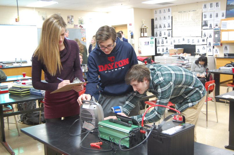 Students Katarina P. (left), Alex Q. (center) and Jack B. (right) from Fairfield High School in Fairfield, OH work on their team's project that won them a national finalist slot in the 2019 Samsung Solve for Tomorrow STEM contest. Photo credit: Angie Neal, courtesy of Kurt Etter.