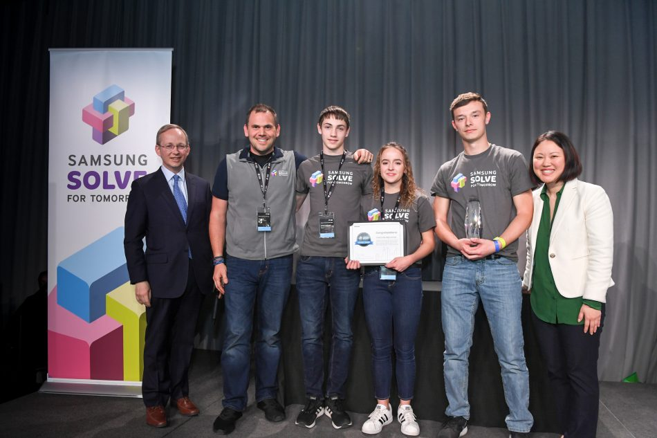 Owensville High School in Owensville, Missouri was named a 2019 national winner in the Samsung Solve for Tomorrow Contest at a ceremony on Tuesday, April 2, 2019 at the Intrepid Sea, Air & Space Museum in New York City. Teacher Kevin Lay and students Jonah Hoffman, Paige Tayloe and Trey Fisher received the award from Samsung's Dr. David Steel, EVP and Head of Corporate Affairs and Ann Woo, Senior Director of Corporate Citizenship. The students won for designing a lock to quickly secure a classroom in the event of a school shooting.