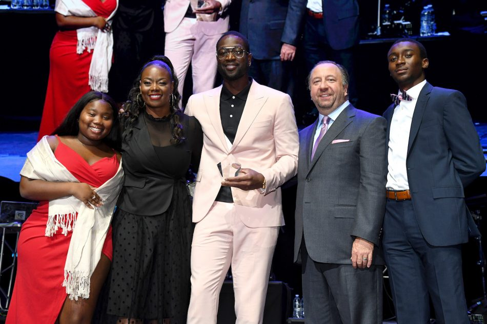 "NBA Champion Dwyane Wade (center), (pictured with two Wade Family Foundation program participants, his sister Tragil Wade and Joe Stinziano, Executive Vice President Consumer Business Division Samsung Electronics America) was honored with the ""Champion of Hope"" Award for his work with the Wade Family Foundation providing support to community-based organizations that promote education, health and social skills for children in at-risk situations. ""What I always said to God was if you give me this opportunity to get my family out of this inner city, I would reach back, I would pull others up with me. I would not go alone,"" said Wade, adding ""I'm thankful to say we've been able to accomplish that so far in the Wade Family Foundation."""