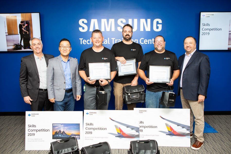 Nicholas Webert, Samsung Electronics America's Director of Product Training; Chris Kim, VP of In-Home Service; Christian Ross of Ross Technology Solutions (2nd place winner); Jonathan Cope of Telco Electronics (1st place winner); Rogel Negron of Appliance Repair Center of Maine (3rd place winner); and Joe Stinziano, Executive Vice President of Samsung Electronics America's Consumer Business division at the Skills Competition awards ceremony.