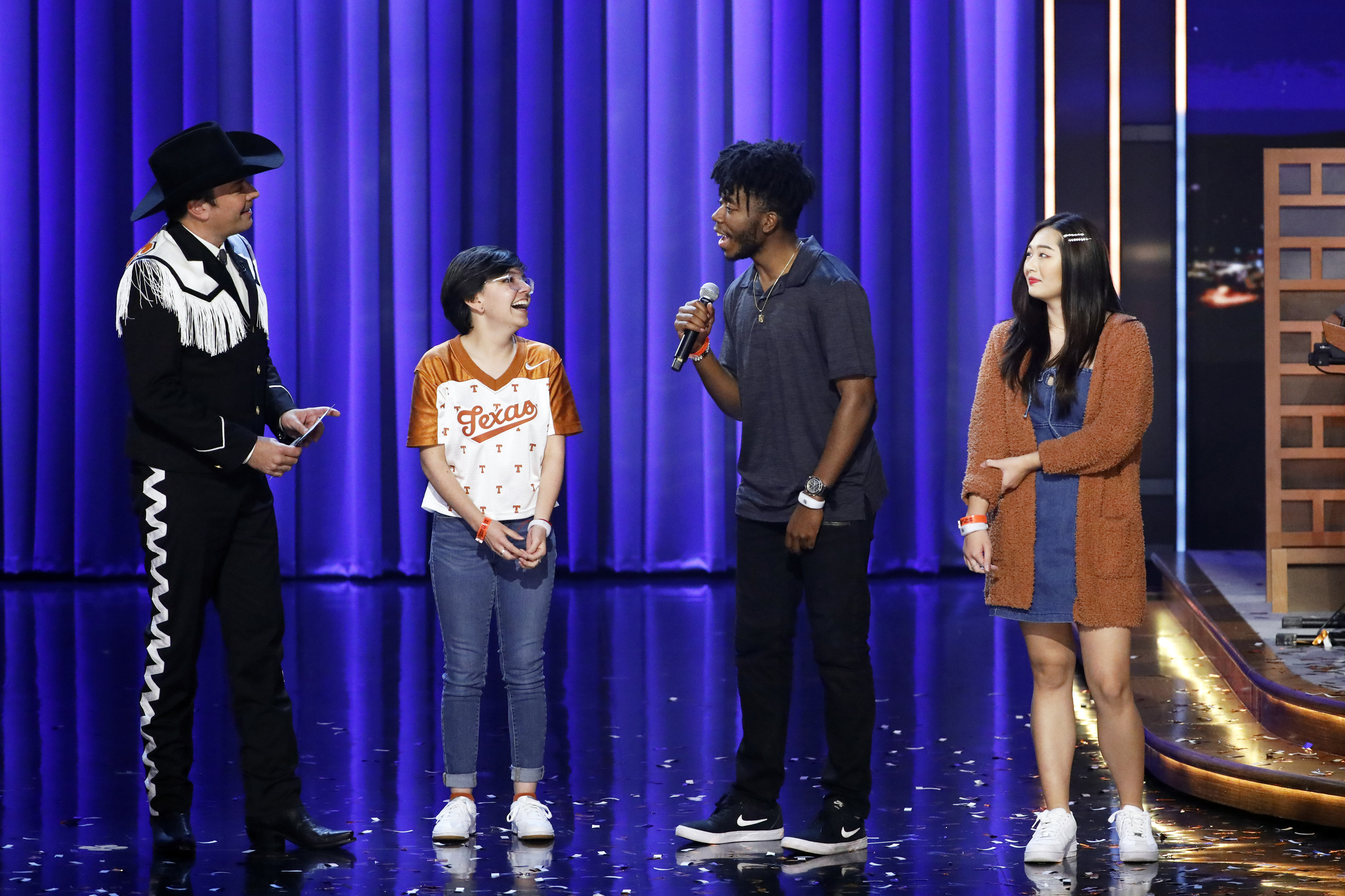 "(L-R) Host Jimmy Fallon with UT Austin Students Alma Zamora, Fitzgerald Alan, and Elizabeth Yoon during the ""Samsung Phone Giveaway"" on November 7, 2019 -- (Photo by: Andrew Lipovsky/NBC/NBCU Photo Bank)"