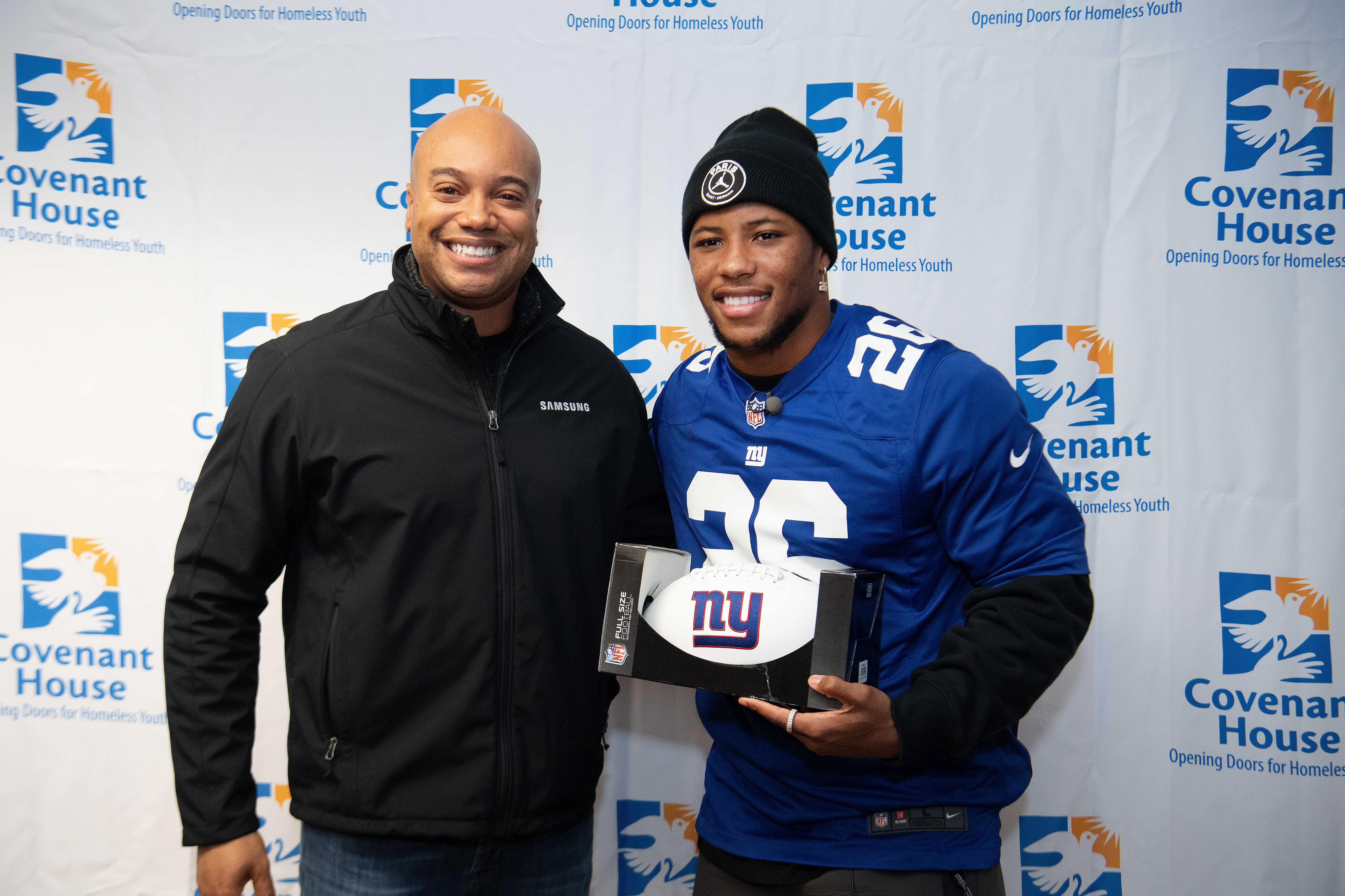 Jamal Haughton and pro-football player Saquon Barkley at the Covenant House New Jersey Executive Sleep Out 2019