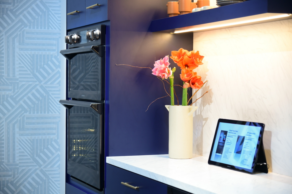 A dishwasher and an oven fit seamlessly together in one of the exhibit kitchens, finished in this year's Pantone Color of the Year, Classic Blue