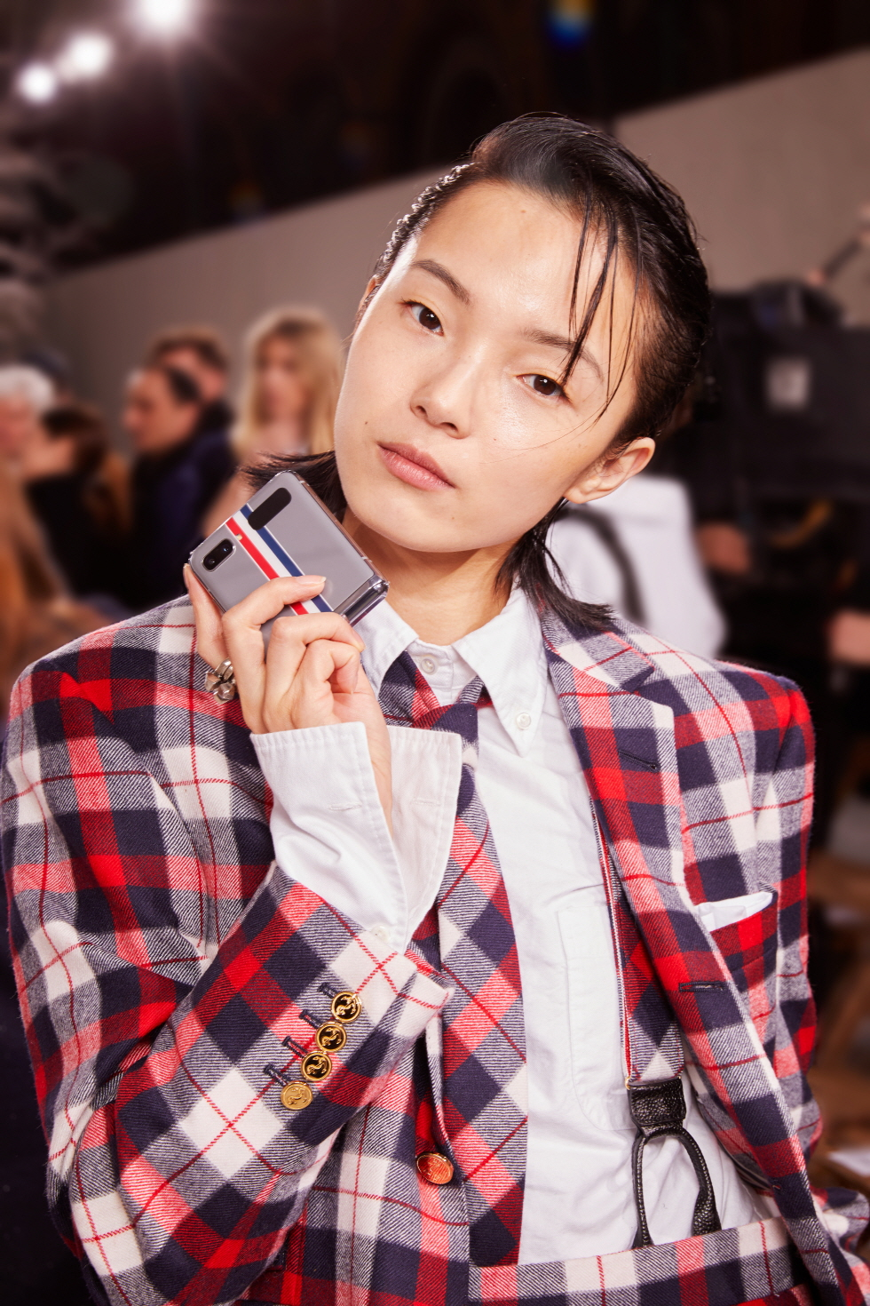Model Xiao Wen Ju with Galaxy Z Flip Thom Browne Edition at Paris Fashion Week.
