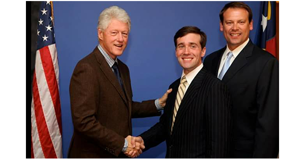 Kevin O'Hanlon shaking hands with President Clinton
